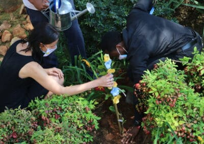 Adél Du Plessis plants a tree with her students for Global Ethics Day at IIE MSA Campus (South Africa).